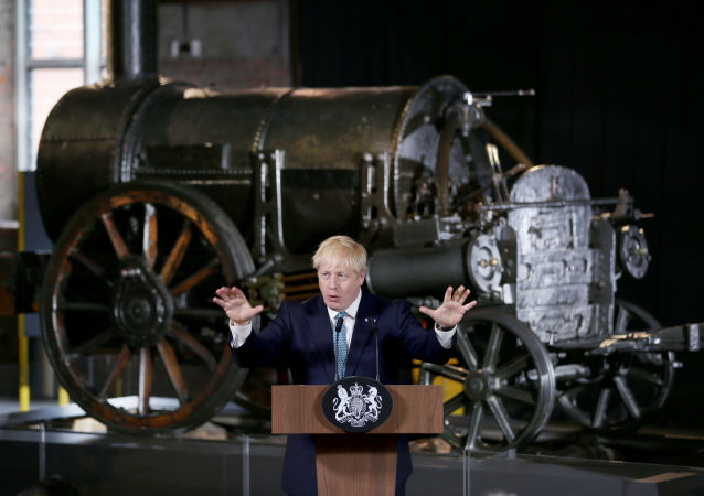 Britain's Prime Minister Boris Johnson gestures during a speech on domestic priorities at the Science and Industry Museum in Manchester, UK, 27 July 2019