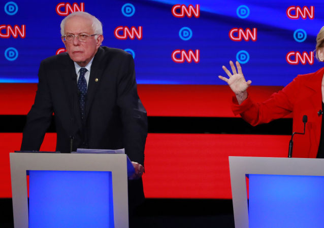 U.S. Senator Bernie Sanders listens as U.S. Senator Elizabeth Warren speaks on the first night of the second 2020 Democratic U.S. presidential debate in Detroit, Michigan, U.S., July 30, 2019.