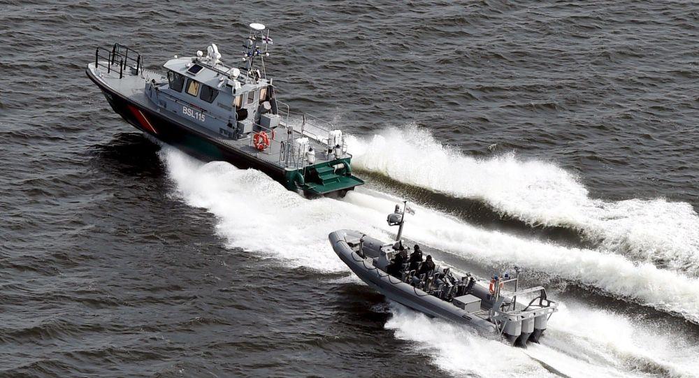 Boats of the Finnish Border Guard patrol the waters outside Helsinki