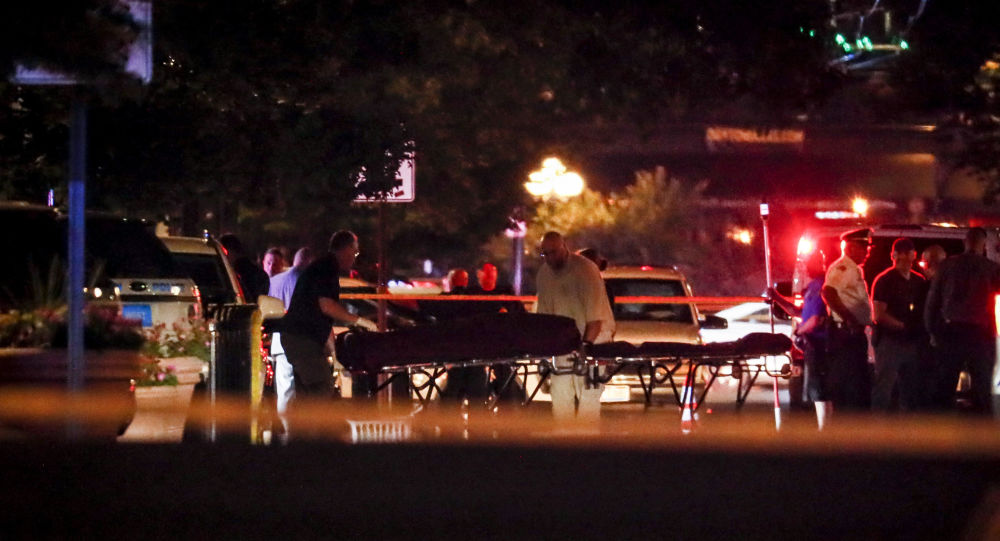 Bodies are removed from at the scene of a mass shooting, Sunday, Aug. 4, 2019, in Dayton, Ohio. Several people in Ohio have been killed in the second mass shooting in the U.S. in less than 24 hours, and the suspected shooter is also deceased, police said