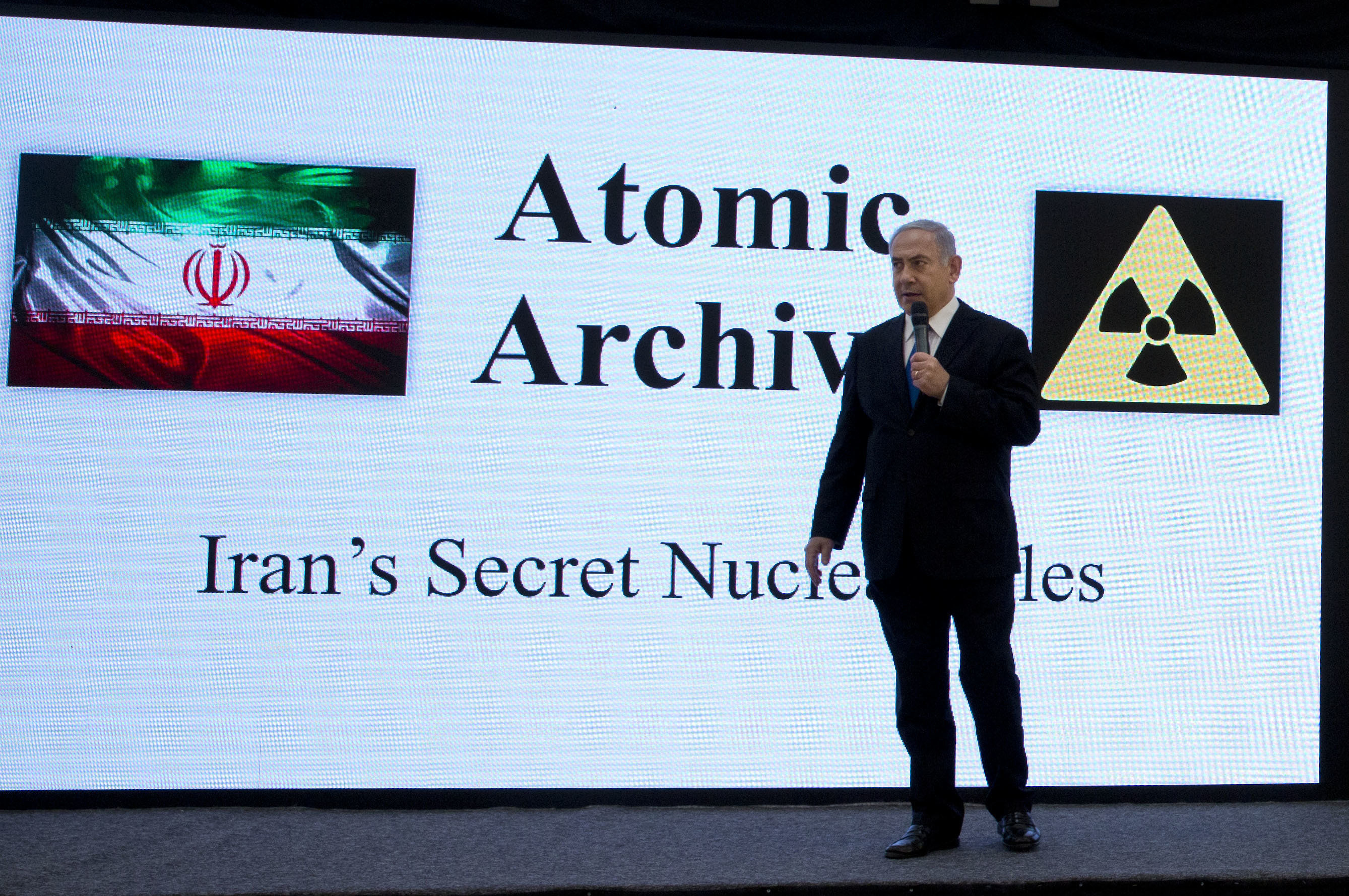 Israeli Prime Minister Benjamin Netanyahu presents material on Iran's purported nuclear program in Tel Aviv