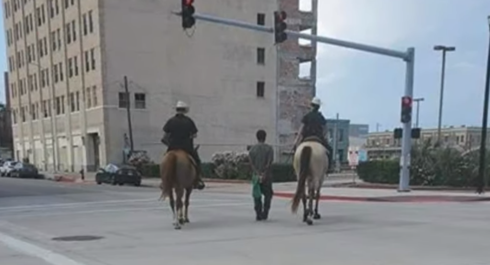 Texas' Galveston Police Department comes under fire after photos emerge online showing two mounted police officers leading a handcuffed man on a rope