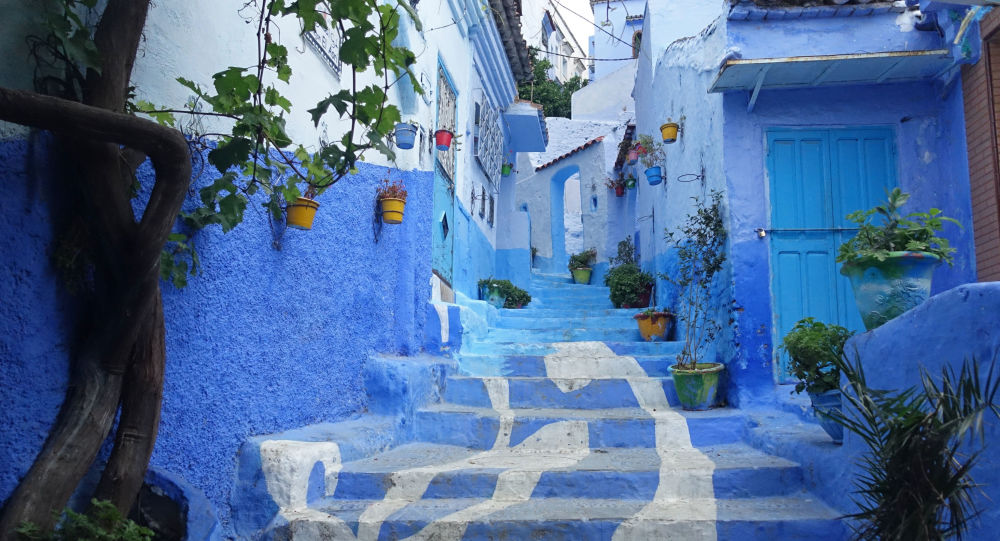 A general view shows a street painted in the tradition blue of the northern Moroccan Rif town of Chefchaouen on June 21, 2017.