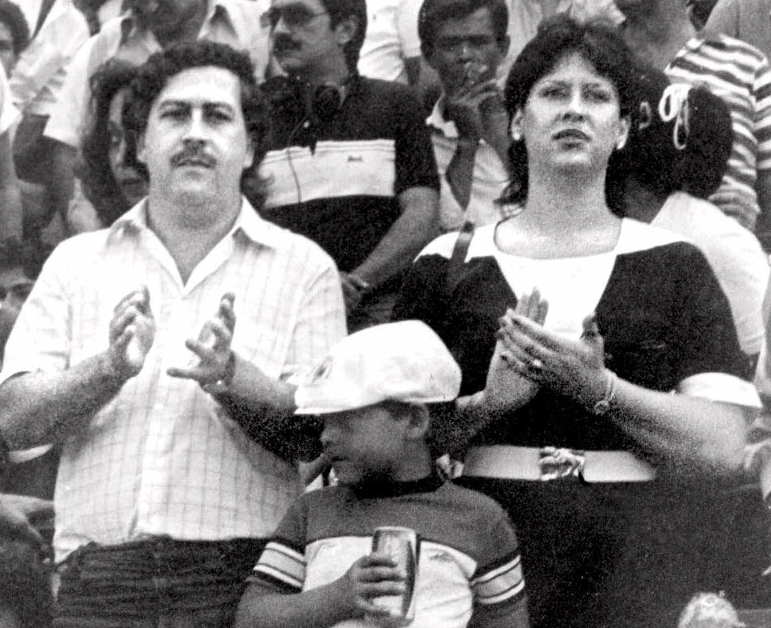 FILE - In this undated file photo, the late Pablo Escobar, former boss of the Medellin drug cartel, his wife Maria Henao and their son Juan Pablo, attend a soccer match in Bogota, Colombia.