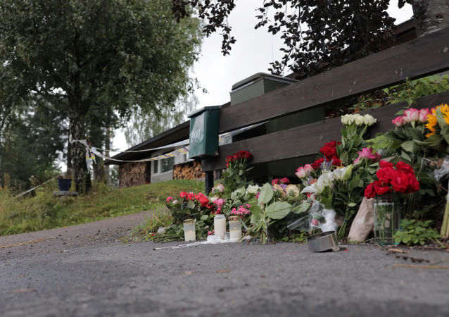 Flowers dedicated to the late stepsister of a suspected gunman, who attacked Al-Noor Islamic Centre Mosque, are seen outside their house in Baerum outside Oslo, Norway, 12 August, 2019.