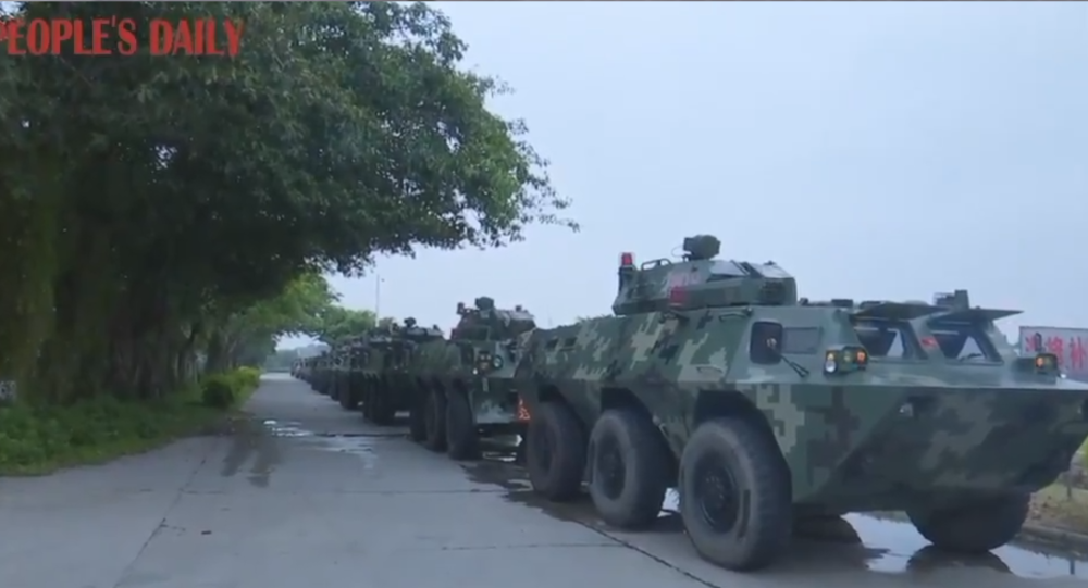 Convoy of armored personnel carriers belonging to the Chinese People's Armed Police Force seen traveling to Guangdong's Shenzhen region ahead of drills