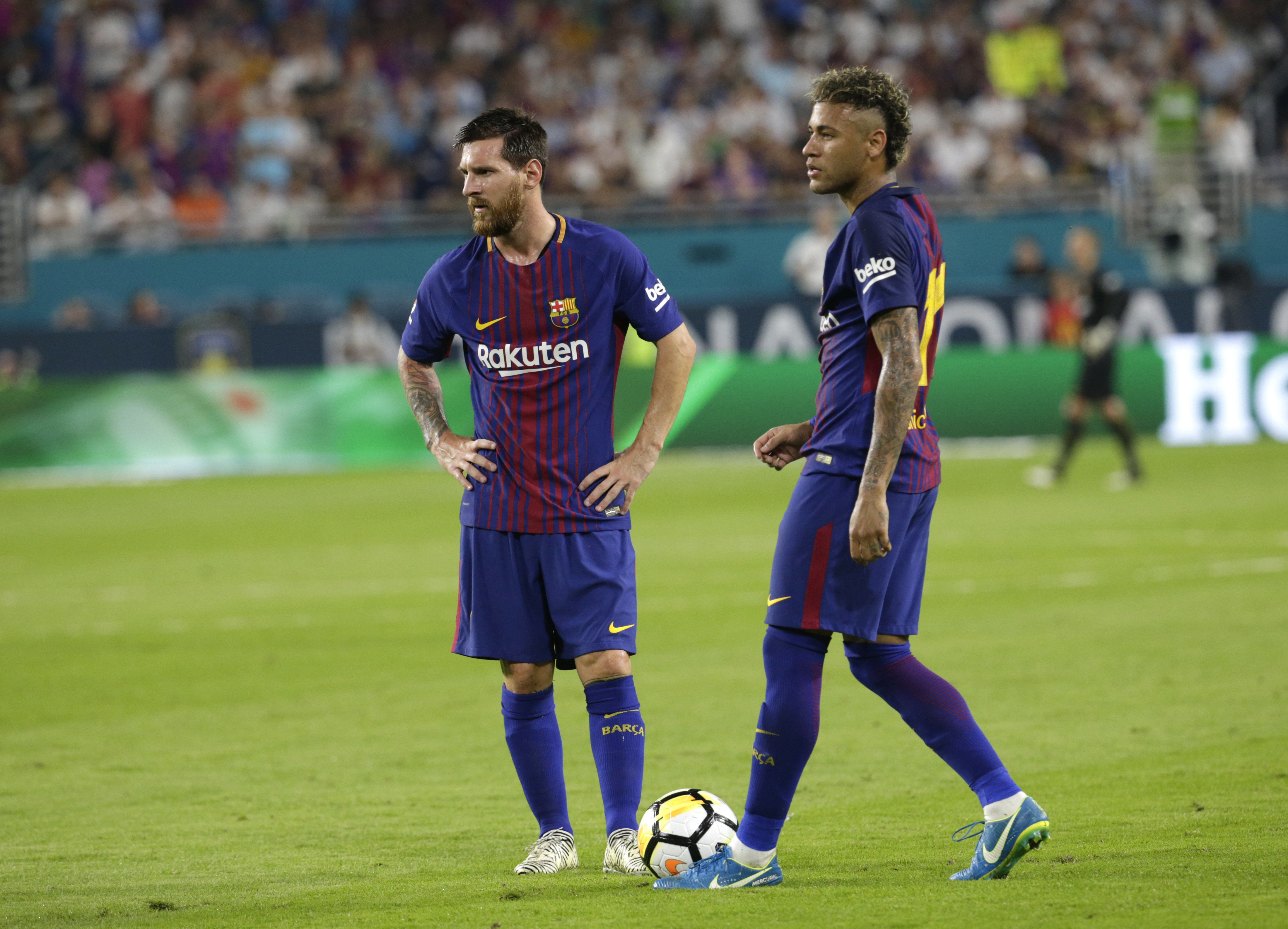 Barcelona's Lionel Messi, left, and Neymar, right, stand on the field during a break in the action during the first half of an International Champions Cup soccer match against Real Madrid, Saturday, July 29, 2017, in Miami Gardens, Fla.Barcelona's Lionel Messi, left, and Neymar, right, stand on the field during a break in the action during the first half of an International Champions Cup soccer match against Real Madrid, Saturday, July 29, 2017, in Miami Gardens, Fla.