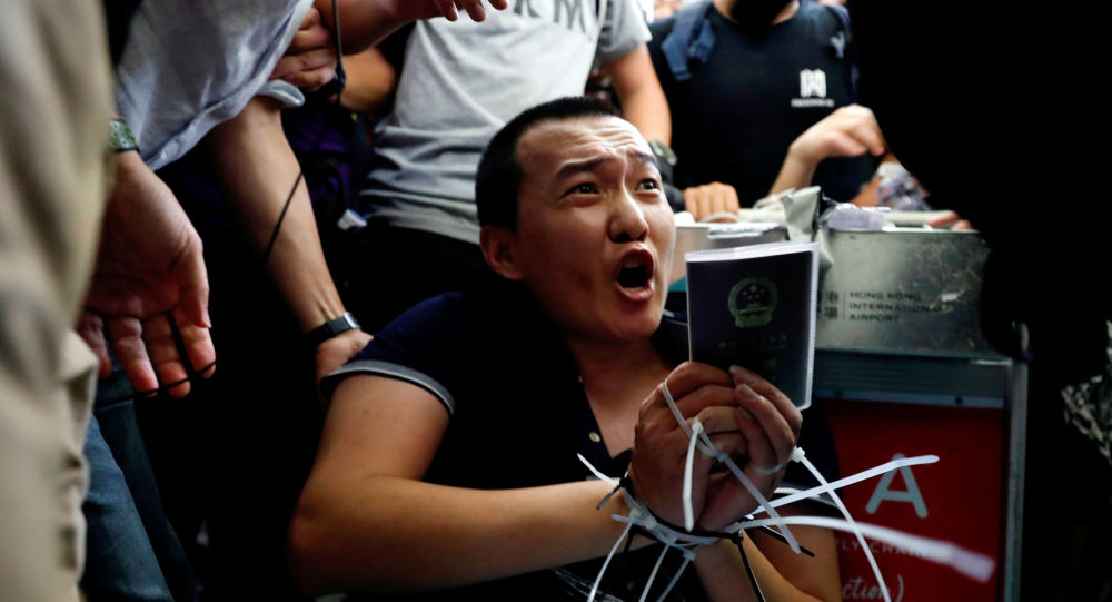 Fu Guohao, reporter of Chinese media Global Times website, is tied by protesters during a mass demonstration at the Hong Kong international airport, in Hong Kong, China, August 13, 2019.