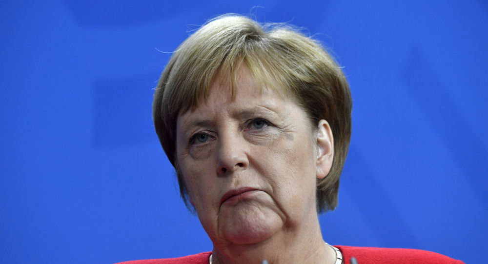 German Chancellor Angela Merkel reacts during a press conference with Moldova's Prime Minister at the Chancellery in Berlin on July 16, 2019.