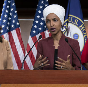 In this 15 July 2019, file photo, U.S. Rep. Ilhan Omar, D-Minn, right, speaks, as U.S. Rep. Rashida Tlaib, D-Mich. listens, during a news conference at the Capitol in Washington.