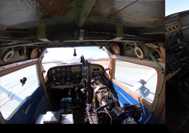 The Air Force Research Laboratory and DZYNE Technologies Incorporated's first two-hour flight using the Robotic Pilot Unmanned Conversion Program called ROBOpilot in a 1986 Cessna 206. August 9. (Screenshot via YouTube)