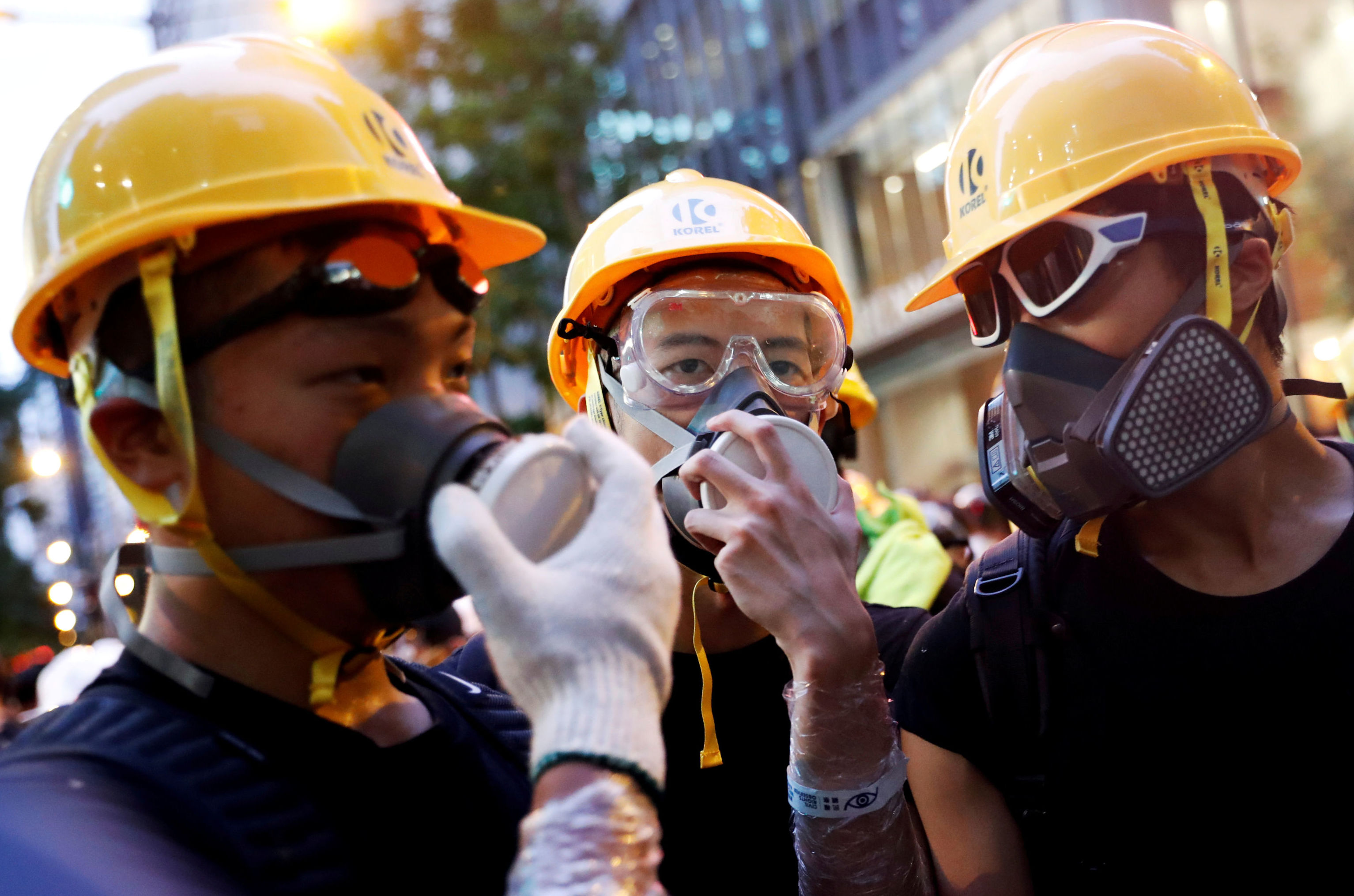 Protesters protect themselves with helmets and masks during a demonstration in Hong Kong