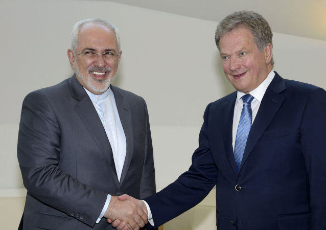 Iran's Foreign Minister Mohammad Javad Zarif, left, shakes hands with  Finland's President Sauli Niinisto at the Presidential residence Mantyniemi in Helsinki, Finland on Tuesday May 31, 2016.