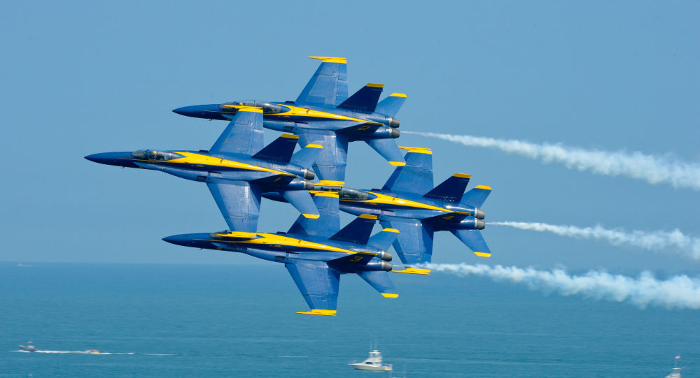 The U.S. Navy flight demonstration squadron, the Blue Angels, perform the Diamond 360 maneuver at the Ocean City Air Show. The Blue Angels are scheduled to perform 68 demonstrations at 35 locations across the U.S. in 2015.