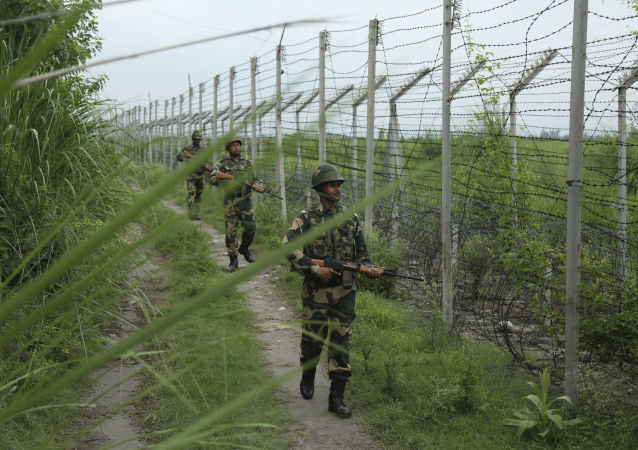 India's Border Security Force (BSF) soldiers patrol near the India Pakistan border fencing at Garkhal in Akhnoor, about 35 kilometers (22 miles) west of Jammu, India, 13 August 2019