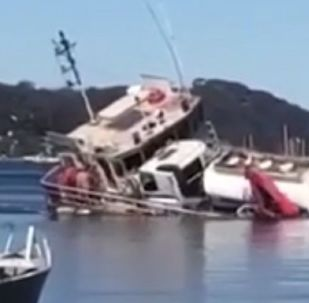 A barge capsizes off Sydney
