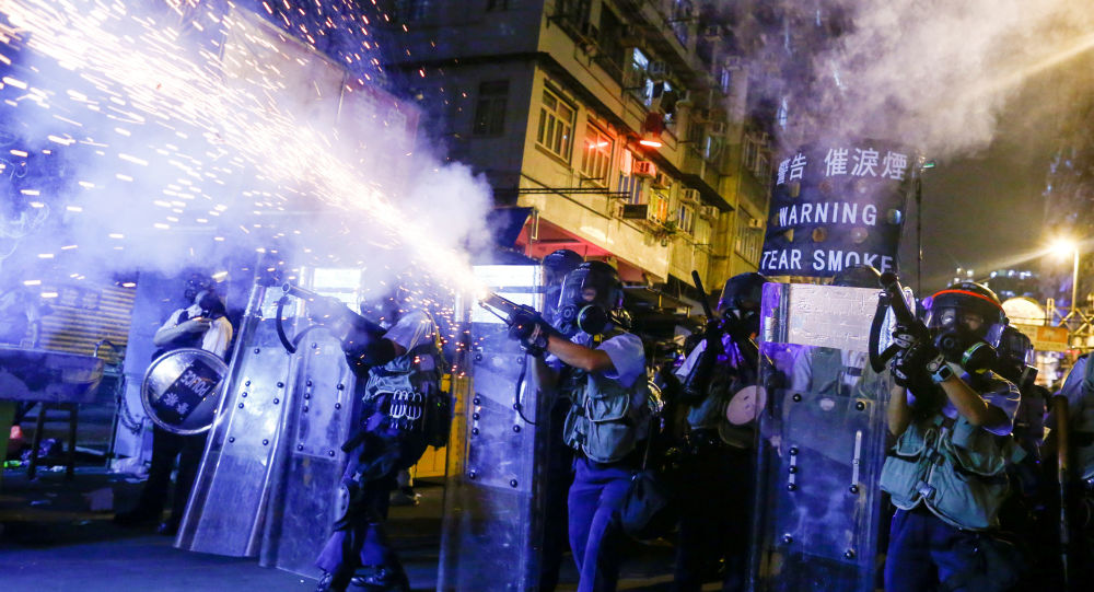 Police fire tear gas at anti-extradition bill protesters during clashes in Sham Shui Po in Hong Kong, China, 14 August 2019