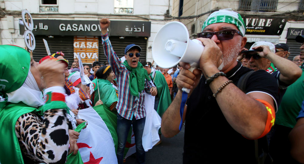 A demonstrator shouts slogans during an anti-government protest in Algiers, Algeria August 23, 2019
