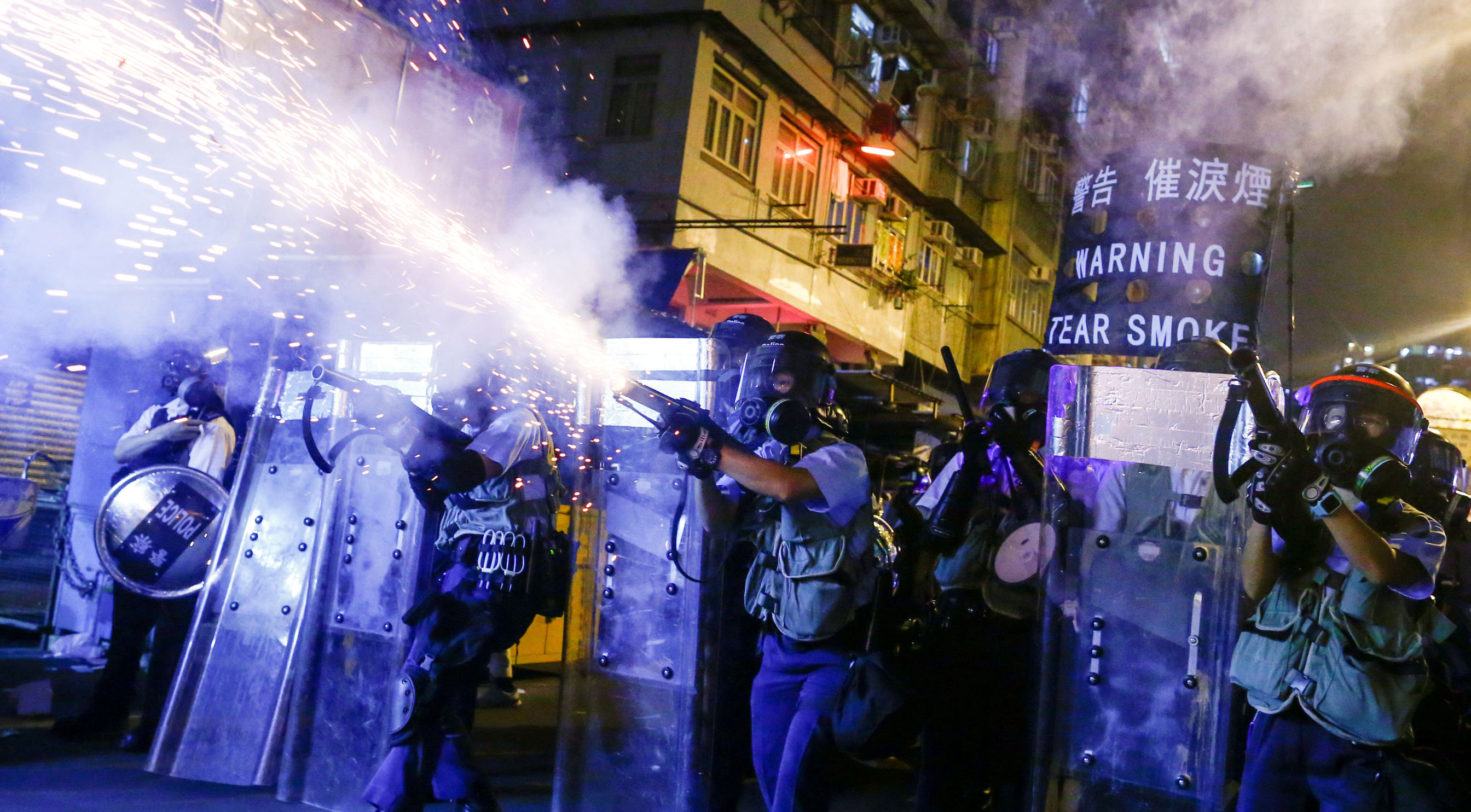Police fire tear gas at anti-extradition bill protesters during clashes in Sham Shui Po in Hong Kong, China, August 14, 2019
