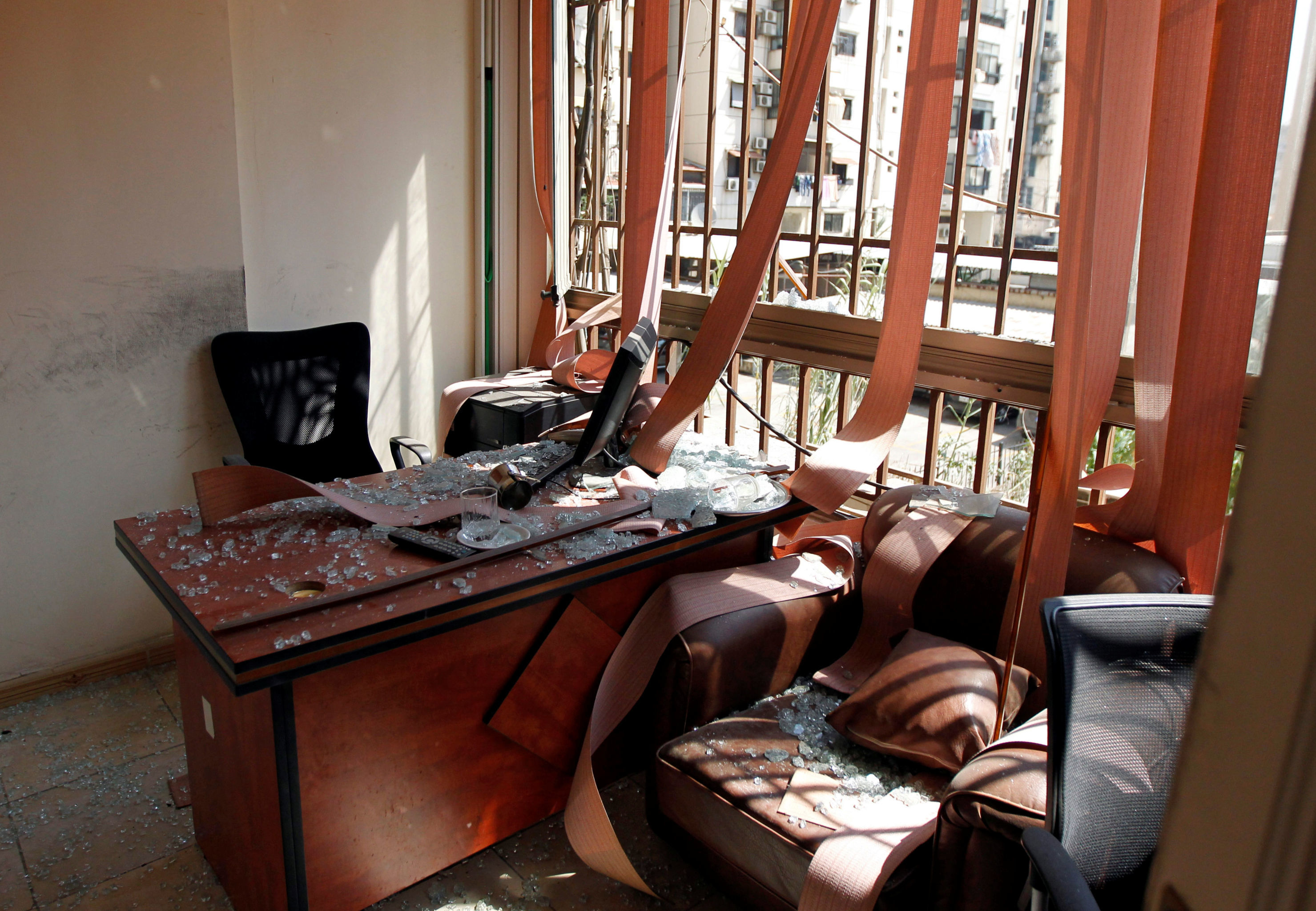 Damage and glass from broken windows is seen inside Hezbollah media center after an Israeli drone fell in the Hezbollah-dominated southern suburbs and a second one exploded near the ground in Dahiyeh suburbs of Beirut, Lebanon August 25, 2019.