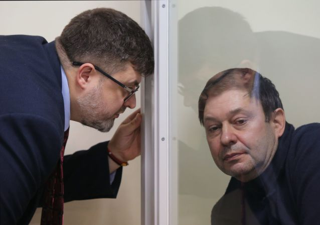 RIA Novosti Ukraine news portal head Kirill Vyshinsky, right, listens to his attorney Andriy Domansky as the Kherson Court of Appeal considers an appeal on extending his arrest in Kherson, Ukraine. On January 31, the Kherson Appeal Court refused to uphold the appeal by the defense of Kirill Vyshinsky against the extension of his arrest