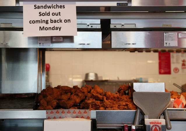 A sign posted inside Popeyes Louisiana Kitchen states that the restaurant is out of their new chicken sandwiches in the Queens borough of New York, U.S., August 23, 2019.