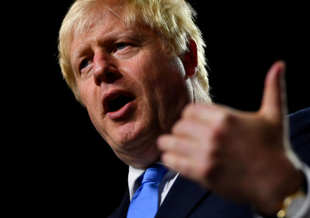 Britain's Prime Minister Boris Johnson gestures during a news conference at the end of the G7 summit in Biarritz, France, August 26, 2019