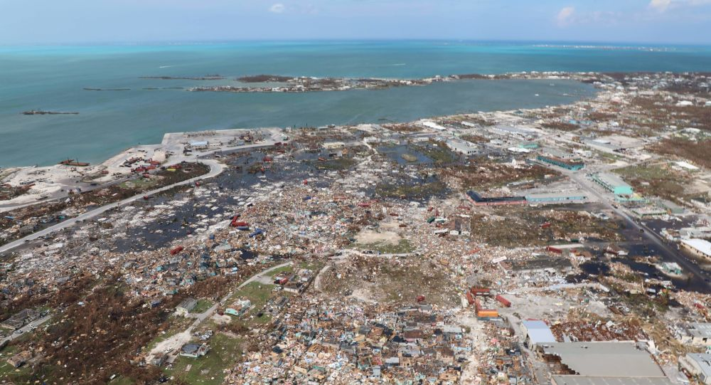 The destruction caused by Hurricane Dorian is seen from the air, in Marsh Harbor, Abaco Island, Bahamas, Wednesday, Sept. 4, 2019. The death toll from Hurricane Dorian has climbed to 20.