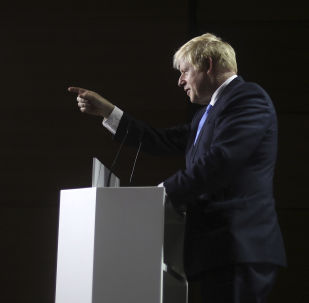 Britain's Prime Minister Boris Johnson gestures as he speaks during a press conference on the third and final day of the G-7 summit in Biarritz, France Monday, Aug. 26, 2019
