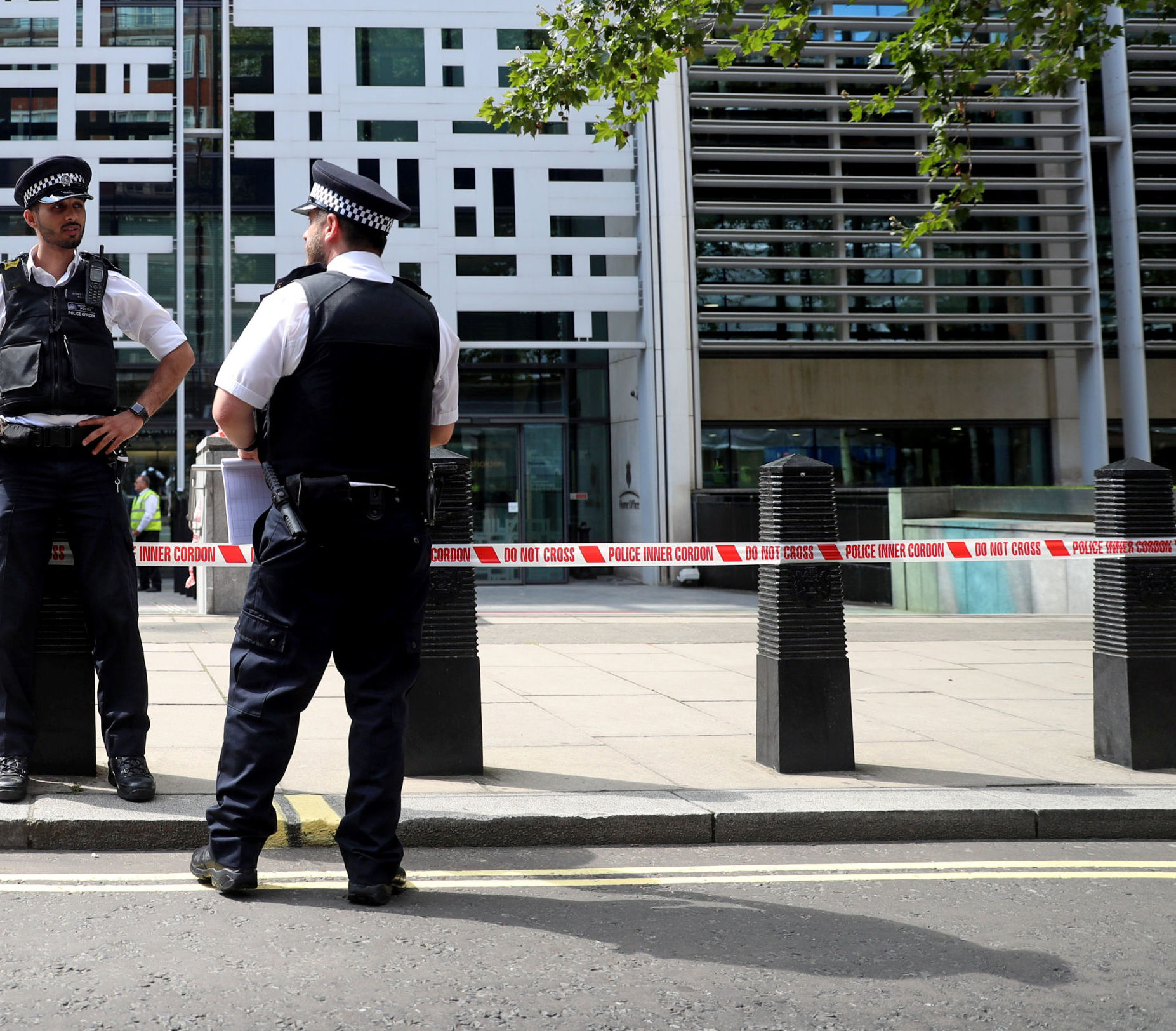 Police officers stand guard in front of the Home Office in London, Britain August 15, 2019.