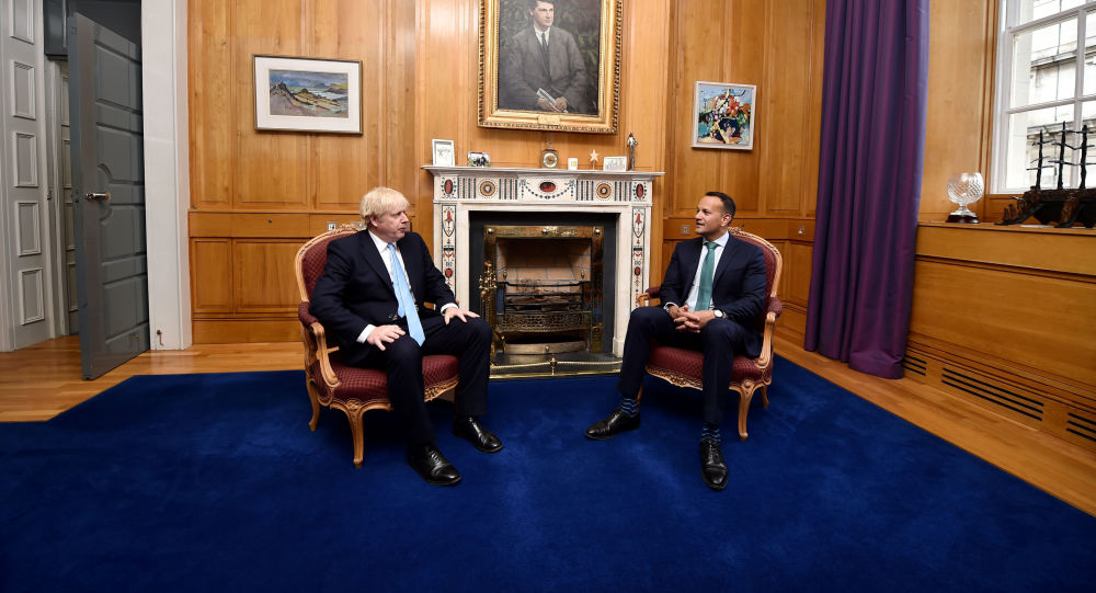 Irish Prime Minister Given Holy Water by Priest To 'Protect' Him From Boris Johnson - Video