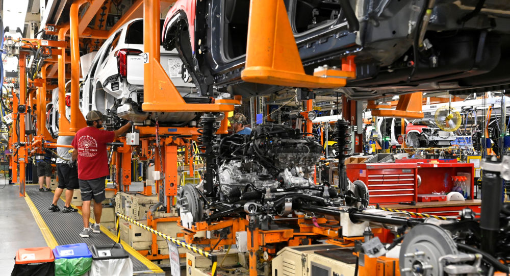 The engine and drive train are pictured with the body on the assembly line at the General Motors (GM) manufacturing plant in Spring Hill, Tennessee, U.S., August 22, 2019