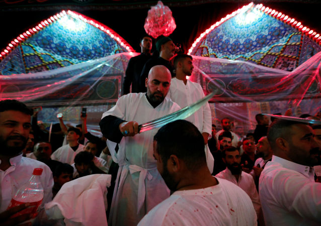 Shi'ite Muslims men flagellate themselves during a ceremony marking Ashura in the holy city of Kerbala, Iraq, September 10, 2019