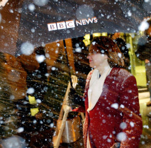 An employee leaves the BBC offices on Portland Place after the release of the Hutton Report lead to the resignation of BBC Chairman Gavyn Davies in London 28 January, 2004