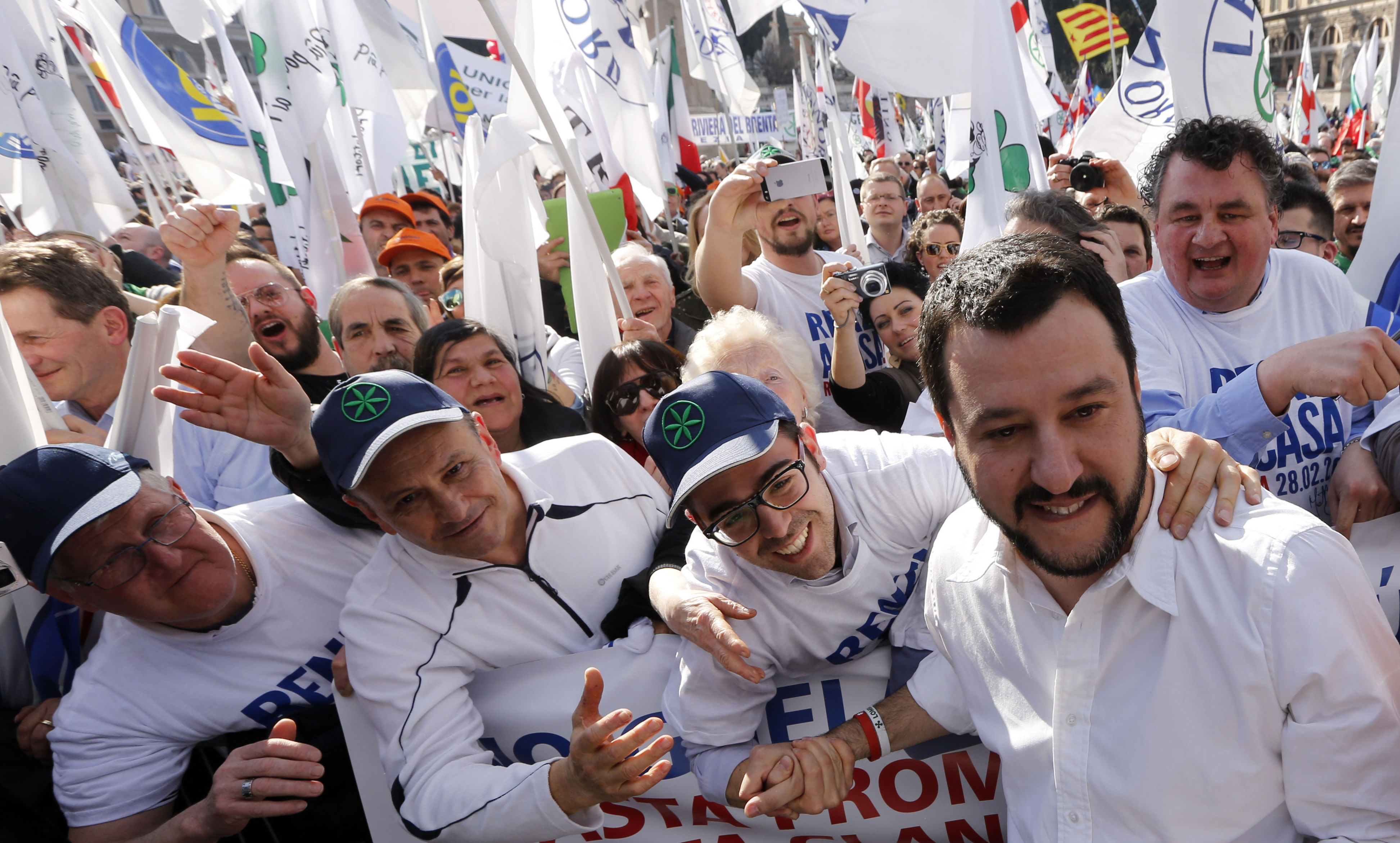 Italian Lega Nord (Northern League) party Matteo Salvini, second right, poses for pictures with supporters during a protest to demand the Italian government keep out immigrants in Rome
