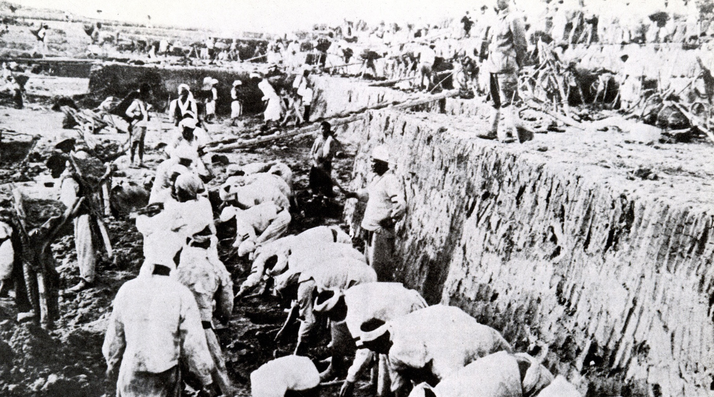 This archives picture received from South Korean newspaper Dong-A Ilbo on August 10, 2010 and taken in 1937 in South Jeolla province shows Korean people working at a gold mine under the surveillance of Japanese soldiers (R) during Japan's colonial rule between 1910 and 1945 in Korea.