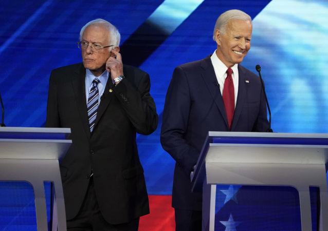 Senator Bernie Sanders and former Vice President Joe Biden stand back to back during a break at the 2020 Democratic U.S. presidential debate in Houston, Texas, U.S. September 12, 2019. REUTERS/Mike Blake