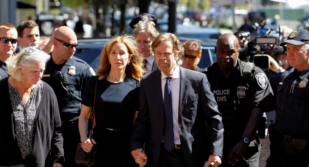Actress Felicity Huffman arrives at the federal courthouse with her husband William H. Macy, before being sentenced in connection with a nationwide college admissions cheating scheme in Boston, Massachusetts, U.S