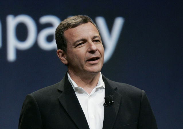 Disney CEO Bob Iger gestures during announcement of new Apple products