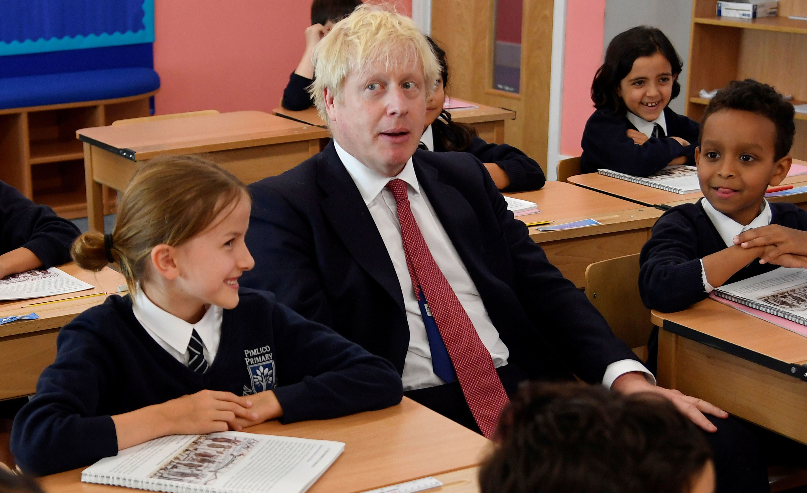 Britain's Prime Minister Boris Johnson attends a class during his visit to Pimlico Primary school in London on September 10, 2019