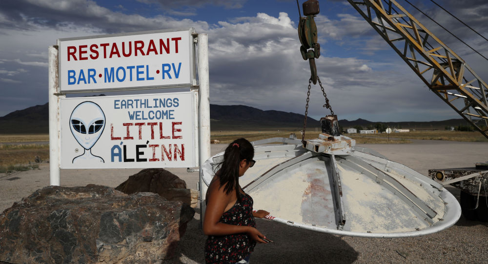 Grace Capati looks at a UFO display outside of the Little A'Le'Inn, in Rachel, Nevada, the closest town to Area 51.