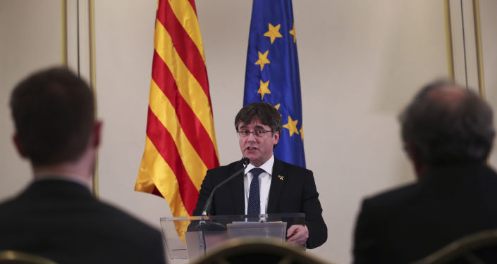 In this Feb. 18, 2019 file photo, Catalonia's former regional president. Carles Puigdemont, addresses a conference in Brussels. A political group that wants Catalonia to break away from Spain and become an independent country said on Sunday, March 10, 2019, that Puigdemont is running for a seat in the European Parliament even though the Spanish government considers him a fugitive. (AP Photo/Francisco Seco, File)