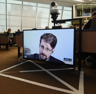 Former US National Security Agency (NSA) contractor and whistle blower Edward Snowden speaks via video link from Russia as he takes part in a round table meeting on the subject of Improving the protection of whistleblowers on March 15, 2019, at the Council of Europe in Strasbourg, eastern France