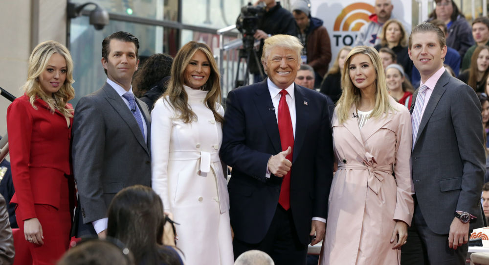 Republican presidential candidate Donald Trump, fourth from left, poses for a photo with family members on the NBC Today television program, in New York, Thursday, April 21, 2016. From left are: daughter Tiffany Trump, son Donald Trump Jr., his wife Melania Trump, daughter Ivanka Trump, and son Eric Trump. (AP Photo/Richard Drew)