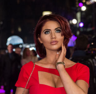 Amy Childs poses for photographers upon arrival at the premiere of the film 'How To Be Single' in London, Tuesday, Feb. 9, 2016