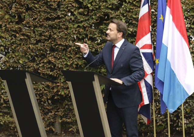 Luxembourg's Prime Minister Xavier Bettel, right, addresses a media conference next to an empty lectern intended for British Prime Minister Boris Johnson after a meeting at the prime ministers office in Luxembourg, Monday, Sept. 16, 2019.
