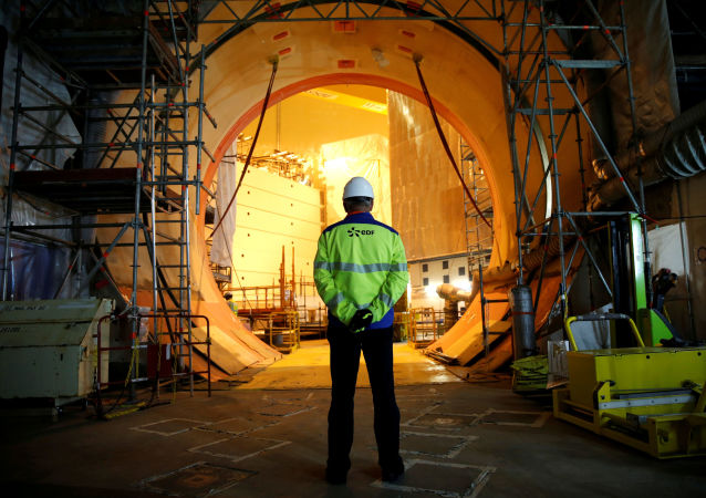An EDF worker is seen on the construction site of the third-generation European Pressurised Water nuclear reactor (EPR) in Flamanville, France, November 16, 2016