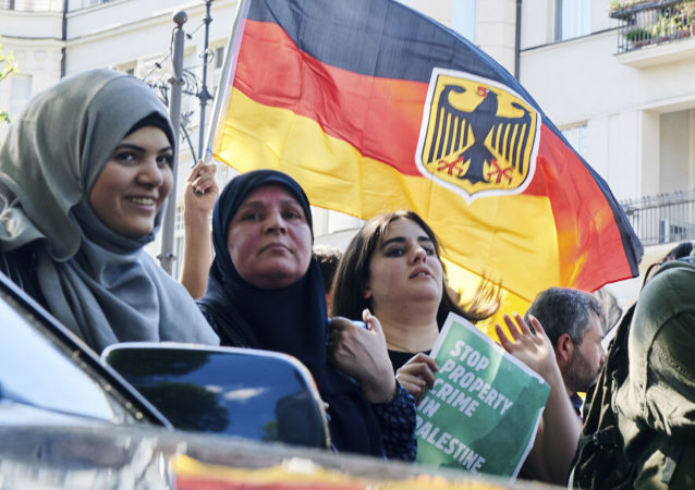 Participants wave a German flag during an anti-Israeli al-Quds demonstration in Berlin, Germany Saturday June 1, 2019, on al-Quds Day at the end of Ramadan, the Muslim month of fasting