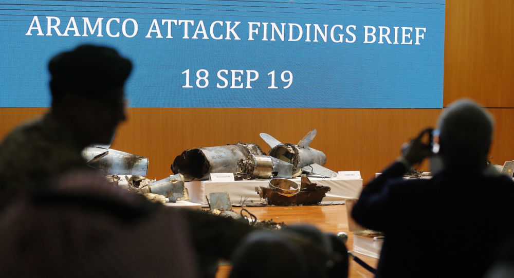 Journalists film what Saudi military spokesman Col. Turki al-Malki said was evidence of Iranian weaponry used in the attack targeted Saudi Aramco's facilities in Abqaiq and Khurais, during a press conference in Riyadh, Saudi Arabia, Wednesday, Sept. 18, 2019