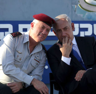 Israeli Prime Minister Benjamin Netanyahu, right, speaks with Israeli Chief of Staff Lt. Gen. Benny Gantz, during a graduation ceremony of navy officers in the northern port city of Haifa, Israel, Wednesday, Sept. 11, 2013